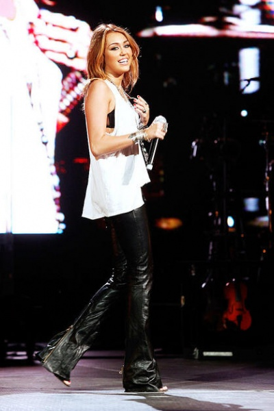 Musician Miley Cyrus performs onstage at Nashville Rising, a benefit concert for flood relief at Bridgestone Arena