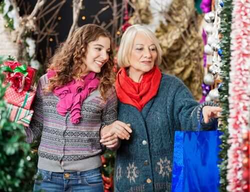 Mother And Daughter Shopping For Christmas Ornaments
