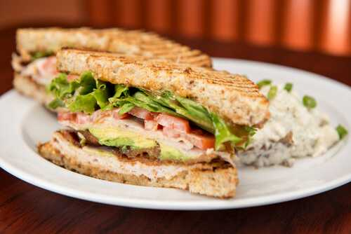 Roasted turkey with avocado slices on whole wheat bread