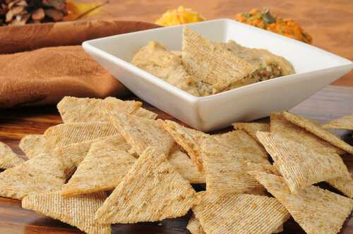 Whole-grain crackers with hummus