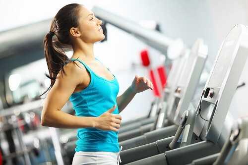 Woman is running on the treadmill
