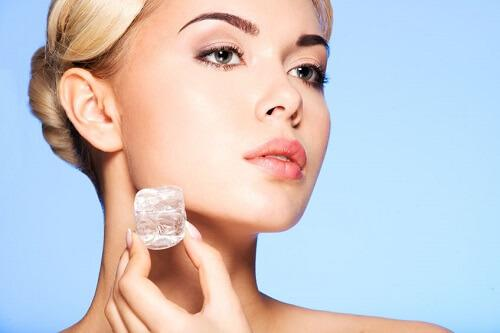 Use ice to reduce redness